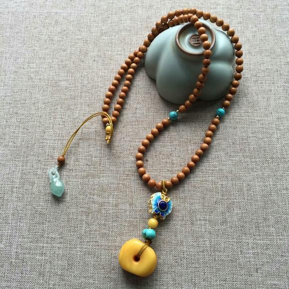 5毫米橄榄核圆珠鸡油黄老蜜蜡项链