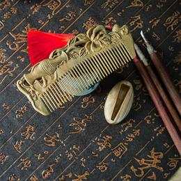 周广胜传统手作天然绿檀木梳